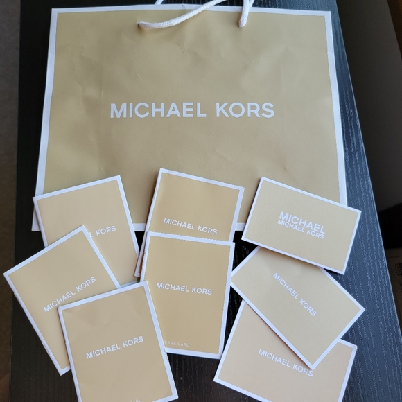 Michael kors bag and tags/booklets
